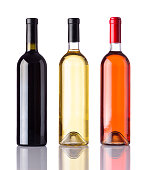 Different Bottles of wine isolated on white background. White, Rose and Red Wine.