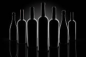 Silhouette of wine bottles on a black background