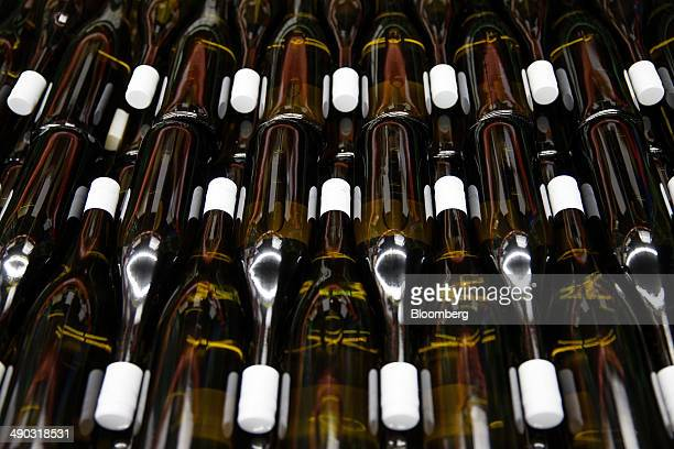 Bottles of wine sit ahead of labeling at the Schmidheiny Weingut a vineyard owned by Thomas Schmidheiny billionaire and Holcim Ltd shareholder in...