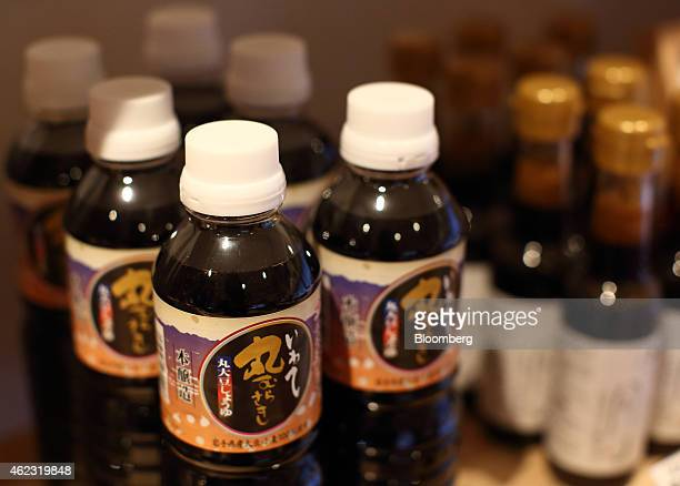 Bottles of Yagisawa Shouten Co soy sauce are displayed for sale at the company's headquarters in Rikuzentakata Iwate prefecture Japan on Friday Jan...