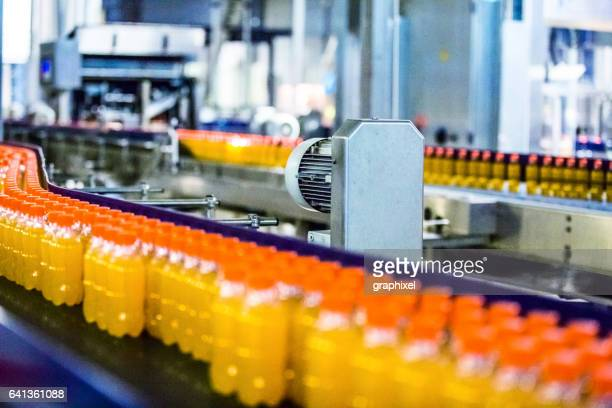 Bottles on Conveyor Belt in Factory