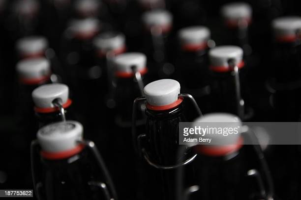 Bottles to be filled with beer for takeout customers are seen at Heidenpeters brewery on November 12 2013 in Berlin Germany In a country known for...