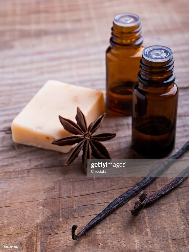 Bottles with aroma oil, vanilla pods and soap : Stock Photo