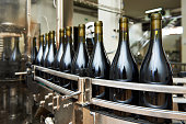 Bottling and sealing conveyor line at winery factory