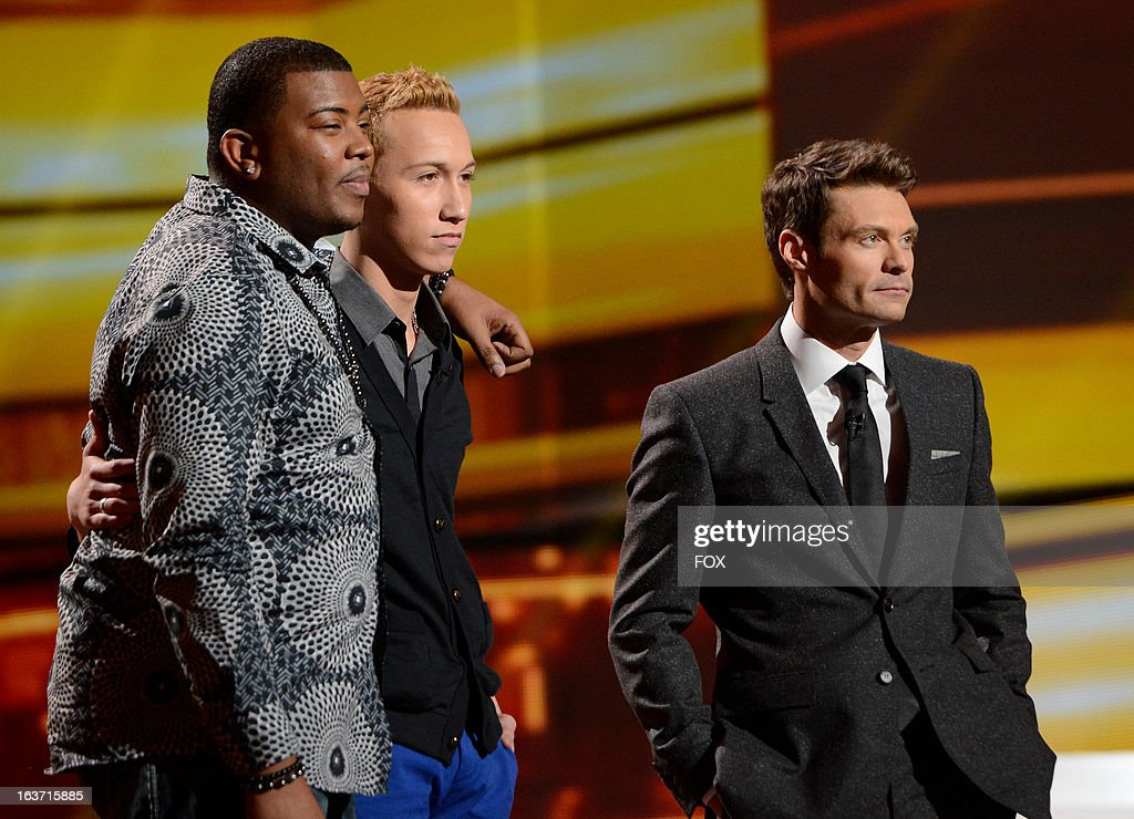 Bottom 2 contestants Curtis Lynch Jr. (L) and Devin Velez and host Ryan Seacrest (R) onstage at FOX's 'American Idol' Season 12 Top 10 To 9 Live Elimination Show on March 14, 2013 in Hollywood, California.