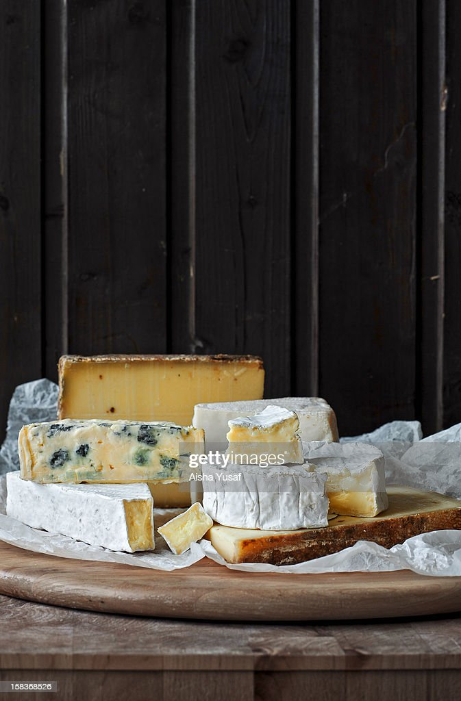 Bottom left hand side triangle shaped with the front bit cut off is called Brie a soft cows' milk cheese originating in France It can be served in...
