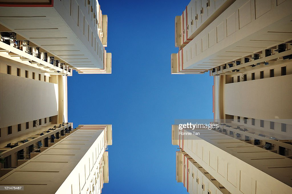 Bottom up view of two adjacent HDB apartment block : Stock Photo
