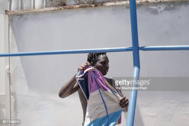 Boubacar Barry immigrant from Senegal is portrayed after a diving lesson organized by the Nautical School Caio Duilio in Messina Italy on July 142017