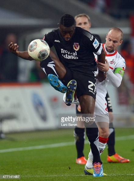 Boubacar Sanogo of Cottbus is challenged by Miso Brecko of Koeln during the Second Bundesliga match between 1 FC Koeln and Energie Cottbus at...