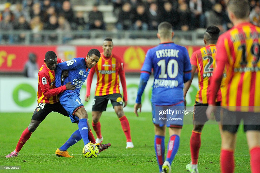 Boubacar Sylla of RC Lens and Alassane Plea of OGC Nice in action during the Ligue 1 match between RC Lens and OGC Nice at Stade de la Licorne on December 19, 2014 in Amiens, France.