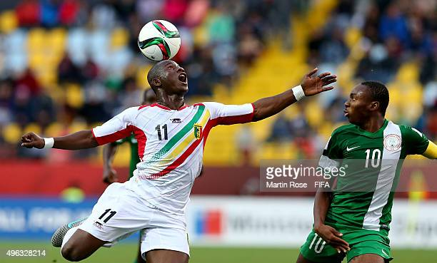 Boubacar Traore of Mali and Kelechi Nwakali of Nigeria battle for the ball during the FIFA U17 Men's World Cup 2015 final match between Mali and...