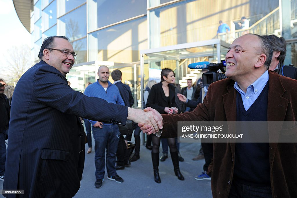 Bouches-du-Rhone's Region member of parliament Patrick Mennucci (L) shakes hands with an inhabitant on April 8, 2013 at the Chanot Park in Marseille, southern France, before a public meeting. Mennucci announced that he will be candidate for the next municipality election in Marseille in 2014.