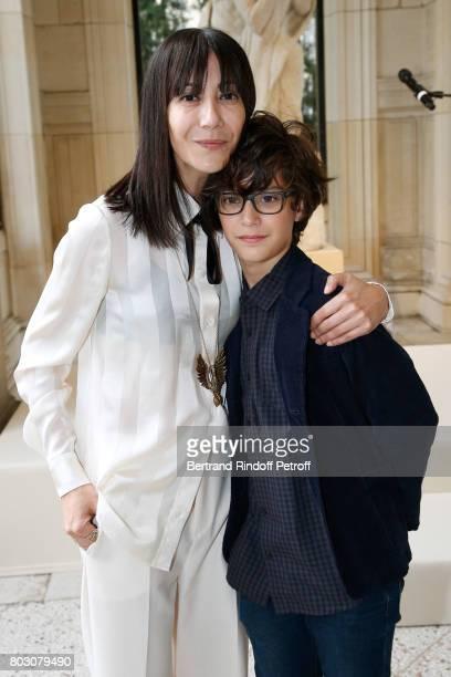 Bouchra Jarrar and her nephew Orian attend Artistic Director of Lanvin Bouchra Jarrar is Decorated 'Officier de l'Ordre des Arts et des Lettres' at...