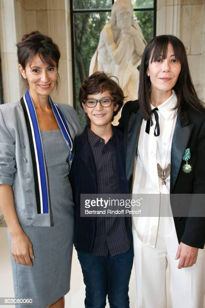 Bouchra Jarrar her nephew Orian and Anissa Jarrar attend Artistic Director of Lanvin Bouchra Jarrar is Decorated 'Officier de l'Ordre des Arts et des...