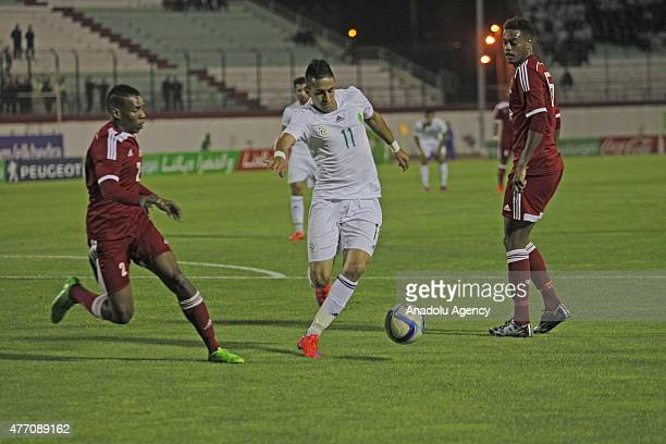 Boudebouz Ryad of Algeria vies for the ball during the 2017 Africa Cup of Nations qualification Group J game between Algeria and Seychelles at...