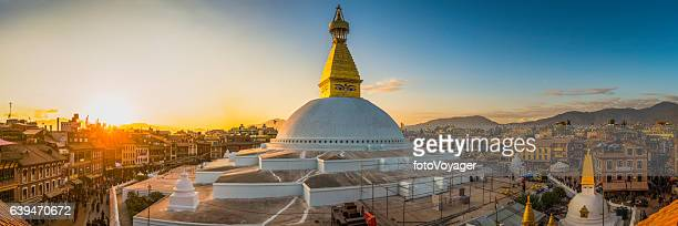 Boudhanath iconic Buddhist stupa and pilgrims at sunset Kathmandu Nepal