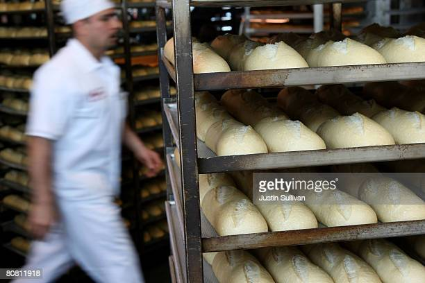 Boudin Bakery bread baker walks by racks with freshly baked sourdough bread at Boudin Bakery April 21 2008 in San Francisco California Boudin the...