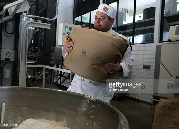 Boudin Bakery master baker Fernando Padilla carries a bag of flour that will be dumped into a mixer to make sourdough bread at Boudin Bakery April 21...