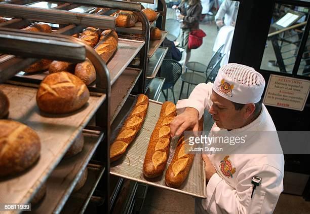 Boudin Bakery master baker Fernando Padilla checks loaves of freshly baked sourdough bread at Boudin Bakery April 21 2008 in San Francisco California...
