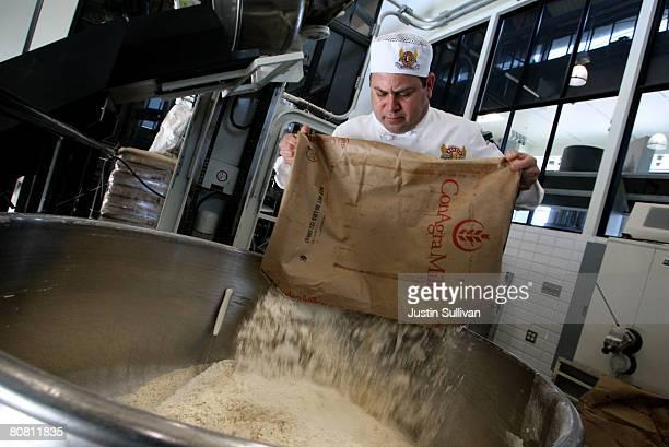Boudin Bakery master baker Fernando Padilla dumps a bag of flour into a mixer to make sourdough bread at Boudin Bakery April 21 2008 in San Francisco...