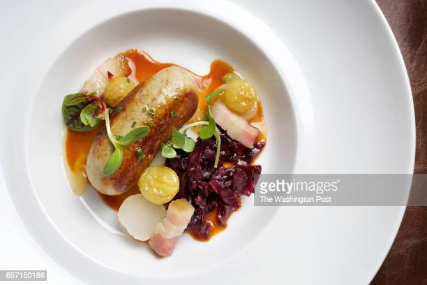 WASHINGTON DC Boudin Blanc appetizer Chicken and Foie Gras Sausage the restaurant's Lardons Braised Red Cabbage and Poached Raisins at the new...