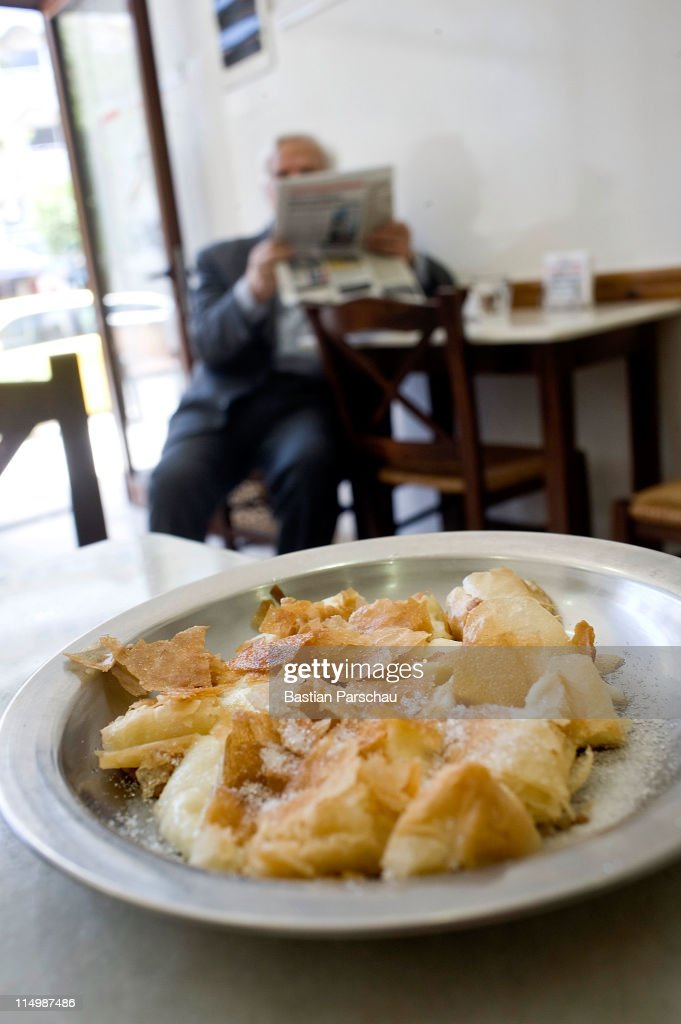 A bougatsa pie a delicious sweet made of white cheese and thin pastry baked in the oven is sevred on May 15, 2011 in Heraklion, Greece.