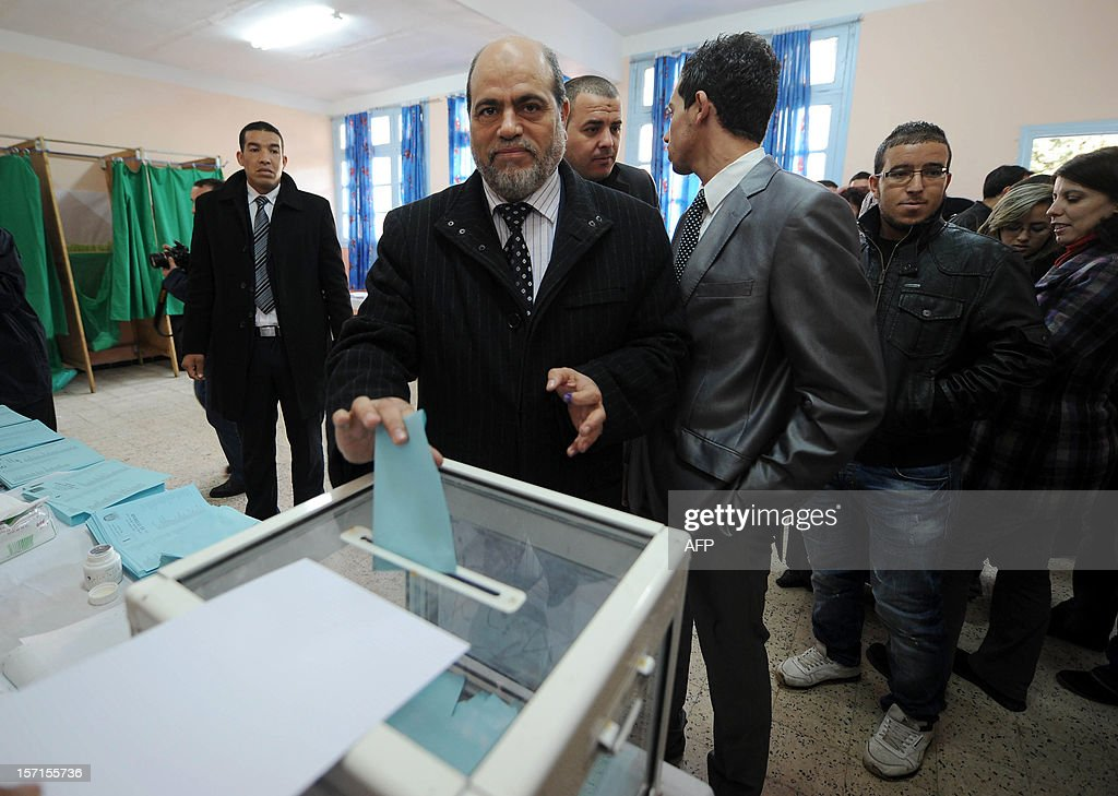 Bouguerra Soltani, leader of the Movement for a Society of Peace (MSP), from the Algerian branch of the Muslim Brotherhood, casts his vote at a polling station in Algiers during municipal and regional assemblies elections on November 29, 2012. Algeria's ruling party, National Liberation Front (FLN), is eyeing a landslide victory in local elections, with numerous opposition groups warning of fraud in a poll that could struggle to mobilise a disaffected electorate.