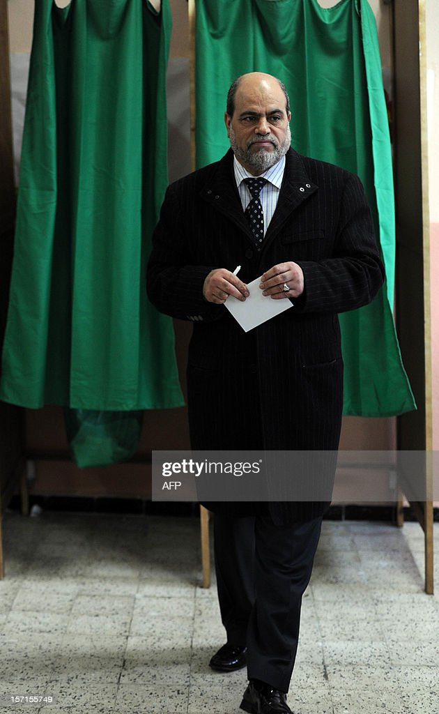 Bouguerra Soltani, leader of the Movement for a Society of Peace (MSP), from the Algerian branch of the Muslim Brotherhood, leaves a voting booth at a polling station in Algiers during municipal and regional assemblies elections on November 29, 2012. Algeria's ruling party, National Liberation Front (FLN), is eyeing a landslide victory in local elections, with numerous opposition groups warning of fraud in a poll that could struggle to mobilise a disaffected electorate. AFP PHOTO/FAROUK BATICHE