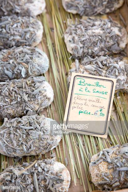 Bouillon a la Sauge artisan goat's cheese with sage herbs soft cheese on sale at street market on September 13 2015 in Bordeaux France
