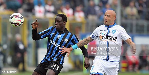 Boukary Drame of Atalanta competes for the ball with Massimo Maccarone of Empoli during the Serie A match between Atalanta BC and Empoli FC at Stadio...
