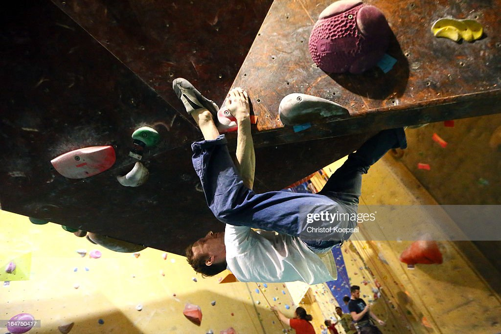 Boulder Arndt Krueger climbs up the wall during the climping and bouldering at Wupperwaende Hall on March 27, 2013 in Wuppertal, Germany.