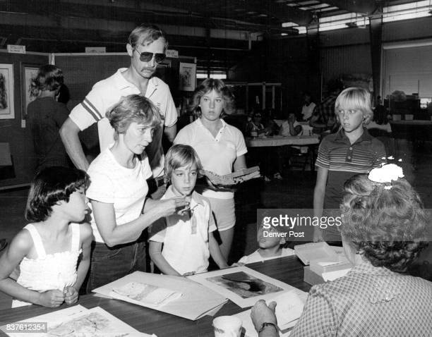 Boulder County Fair Is Serious Business For Seebaum Family Mary Seebaum speaks to the woman accepting entries in the exhibit hall as the family goes...