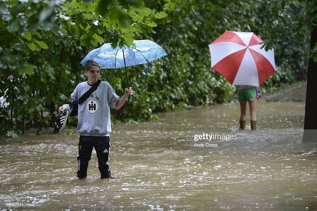 Boulder High School student, Blaise Warner, left, negotiates a bike path, under water because of a swollen Boulder Creek near 17th Ave. and Athens in Boulder Colorado, Thursday morning, September 12, 2103 during heavy rain and flooding in the area. Blaise's sister, Maddie, right, turned back to try and different route.