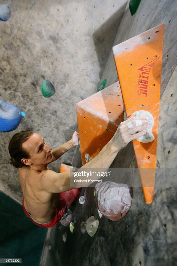Boulder Lars Huke climbs up the wall during the climping and bouldering at Wupperwaende Hall on March 27, 2013 in Wuppertal, Germany.