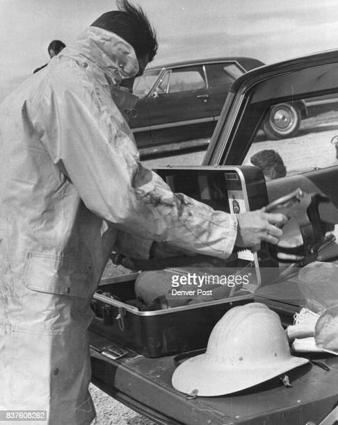 Boulder Patrolman Paul Eller dons a fireman's coat hat boots oxygen mask and gloves as he gets ready to tackle the 'First Aid Fire Extinguishing'...