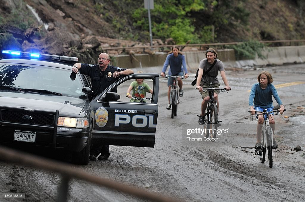 Boulder Police try to keep residents from going up Boulder, Canyon after severe flooding due to heavy rains and swolen rivers caused damage on roads and homes September 13, 2013 in Boulder, Colorado. The historic flooding forced thousands to evacuate the area and more rain is predicted through the weekend.