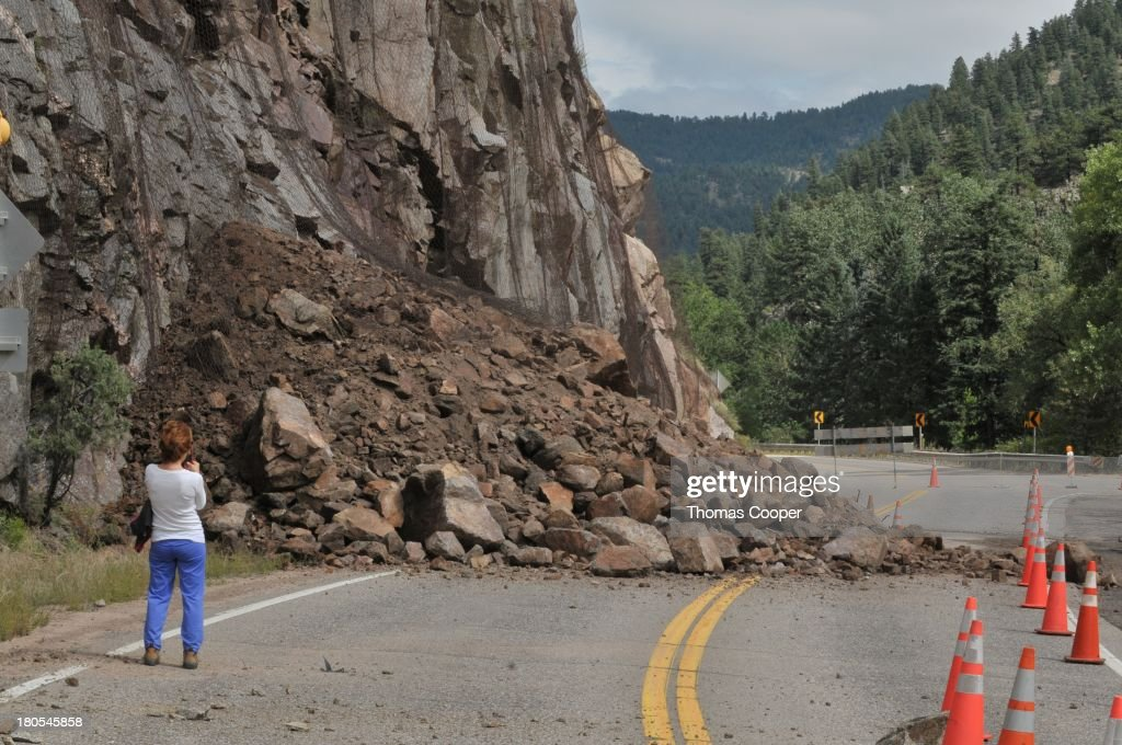 A Boulder resident looks over a large mudd slide up Boulder Canyon, severe flooding due to heavy rains and swollen rivers on September 13, 2013 in Boulder, Colorado. The historic flooding forced thousands to evacuate the area and more rain is predicted through the weekend.