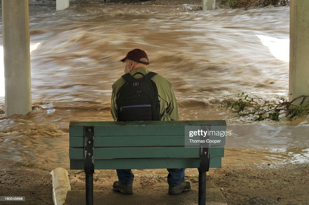 Boulder resident looks over Boulder Canyon flooded due to heavy rains and swollen rivers on September 13, 2013 in Boulder, Colorado. The historic flooding forced thousands to evacuate the area and more rain is predicted through the weekend.