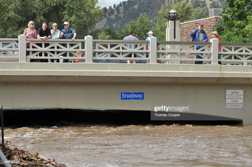 Boulder residents look over Boulder Canyon flooded due to heavy rains and swollen rivers on September 13, 2013 in Boulder, Colorado. The historic flooding forced thousands to evacuate the area and more rain is predicted through the weekend.