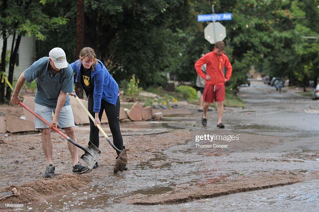 Boulder residents try to re-direct flood waters near Boulder Canyon after flooding due to heavy rains and swolen rivers killed 4 and caused some of the worst flooding in over 50 years September 13, 2013 in Boulder, Colorado. The historic flooding forced thousands to evacuate the area and more rain is predicted through the weekend.