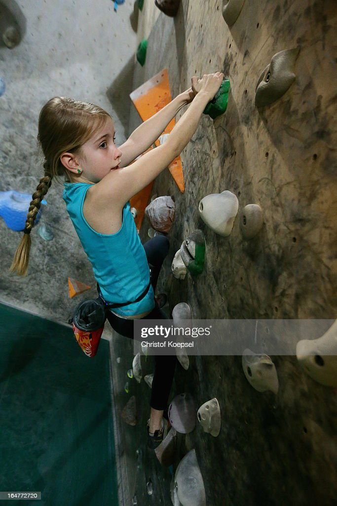 Boulder Ronja Joest climbs during the climping and bouldering at Wupperwaende Hall on March 27, 2013 in Wuppertal, Germany.