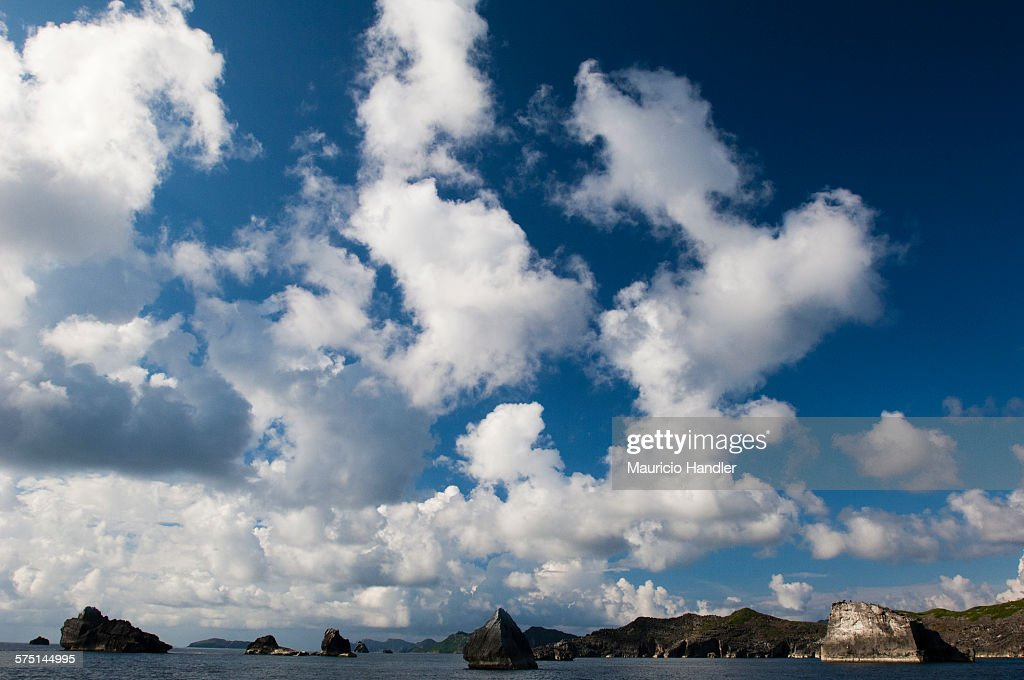 Boulders and blue water off Chichi-Jima Island.