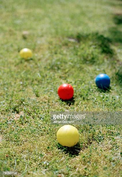 Boule balls on a lawn.
