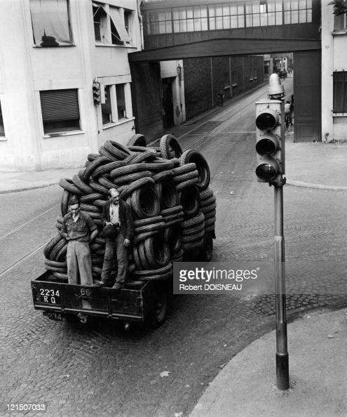 Boulogne Billancourt Workers On A Truck Filled With Tyres
