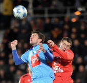 Boulogne's Johan Ramare vies with Caen's Gregory Leca during their French Cup football match on January 24 2009 at the Liberation stadium in...