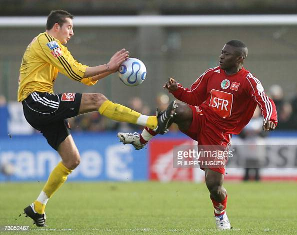 Calais' midfielder Jeremy Provost fights for the ball with Sedan's forward Marcus Mokake during the French Cup round of sixteen football match Calais...