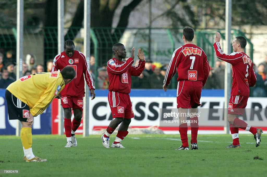 Sedan's forward Marcus Mokake celebrates after scoring a goal during the French Cup round of sixteen football match Calais vs Sedan 20 January 2007...
