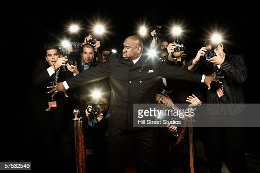Bouncer holding photographers back