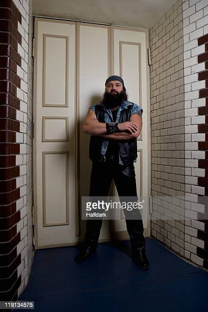 A bouncer standing in front of a door