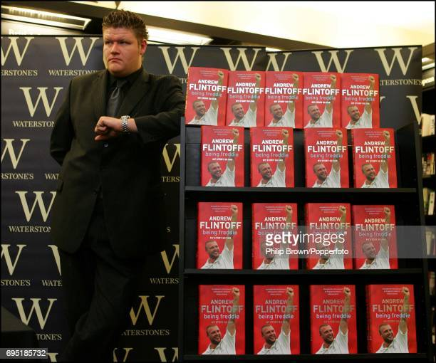 A bouncer stands guard while Andrew Flintoff signs copies of 'Being Freddie' at Waterstones in London on 27th October 2005